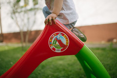 Child on plastic slide toy in the garden.