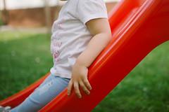 Child sliding down a slide at home.