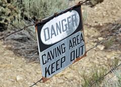 Warning sign next to mined-out gilsonite dike (north of Bonanza, Utah, USA) 1
