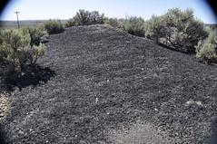 Gilsonite piled up next to Cowboy Dike (north of Bonanza, Utah, USA) 2