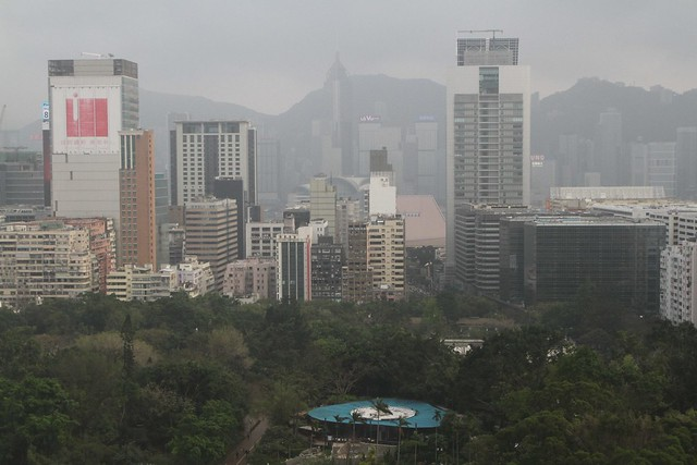 Hazy morning looking over Kowloon Park towards Victoria Harbour and Hong Kong Island