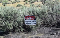 Warning sign next to mined-out gilsonite dike (north of Bonanza, Utah, USA) 3