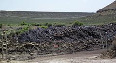 Gilsonite & waste material piled up next to Cowboy Dike (north of Bonanza, Utah, USA) 1