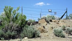 Warning sign next to mined-out gilsonite dike (north of Bonanza, Utah, USA) 2