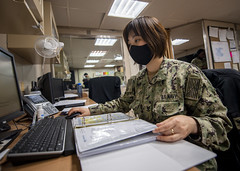 A Sailor works in the supply office aboard USNS Mercy (T-AH 19).