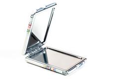 Pocket mirror open on a white background