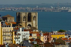 Lisbon Cathedral mixed with urban buildings and the Tagus River