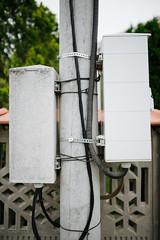 Base Station on electricity post. Wireless Communication Antenna Transmitter.