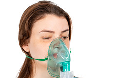 Mask for inhalation on the girl's face. Respiratory disease treatment concept
