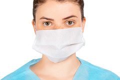 The girl's face in a protective medical mask. Disease prevention