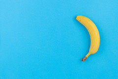 Flat lay Banana on the Blue background with copy space