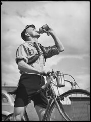 Rider carrying spare inner tubes, 'Thousand Mile Cycle Race', New South Wales, 10 October 1945, Alec Iverson
