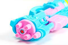 Plastic water gun over white, closeup