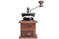 Manual coffee grinder for grinding coffee beans on white background