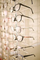 Modern glasses in optical store.