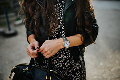 Attractive girl with black jacket and bag