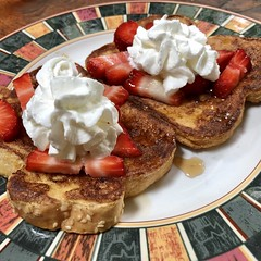 French Toast With Strawberries, Maple Syrup, and Whipped Cream
