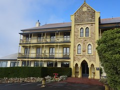Adelaide Hills. Mount Lofty Ranges. Mount Lofty House was built in 1856. Part of it was destroyed in 1983 bushfires. It became the Mecure Hotel in 1986 when this new part in Gothic style was added to it.  .