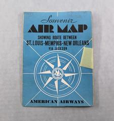 10.117.E Souvenir Air Map American Airways Route between St. Louis Memphis-New Orleans via Jackson Date 1932 Color is Blue with white compass on front black print