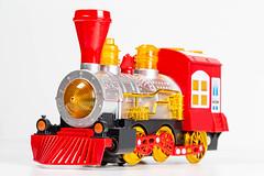 Children's plastic toy train on white