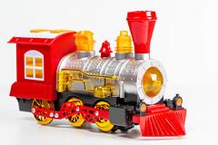 Plastic children's train on a white background