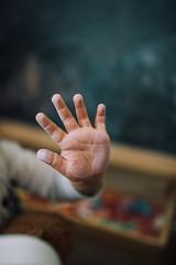 A dirty children's hand of chalk closeup.