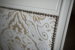 Beautiful handmade cover and details on glamour white chair closeup.