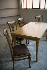 Chairs and table for kitchen in workshop.