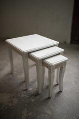 Three white tables.