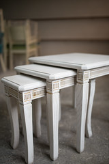 Three beautiful white tables in workshop.