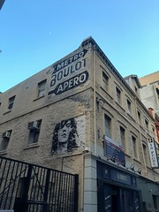 Adelaide. Gresham Street. Advertising on an old building. Metro Boulot Apero. French motto of a typically French style bar.