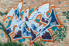 The old wall, painted in color graffiti drawing blue aerosol paints, street art
