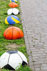 Element of sidewalk design and protection from car parking in the form of balls
