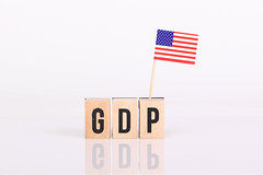 Wooden blocks with the word GDP and flag of USA