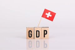Wooden blocks with the word GDP and flag of Switzerland