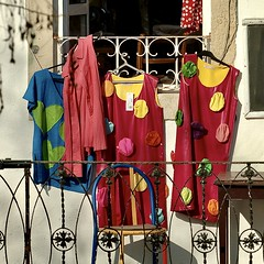 Shop in a 1st floor exhibiting the coulorful woman clothes that they sell