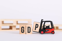 Forklift holds wooden letter block P to complete word GDP