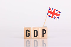 Wooden blocks with the word GDP and flag of United Kingdom