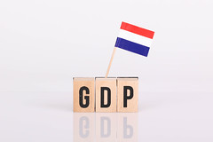 Wooden blocks with the word GDP and flag of Netherlands