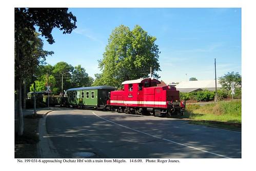 Oschatz. 199 031-6 & train at crossing. 14.6.09