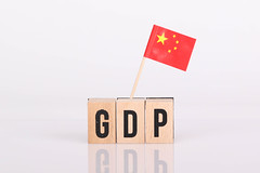 Wooden blocks with the word GDP and flag of China