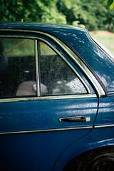 Raindrops on back car door.