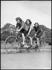 Women on a three seater tandem bicycle, Malvern Star cycle series, 28 September 1938
