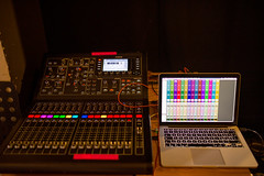 Audio mixer and laptop on backstage for mixing audio.