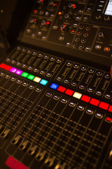 Closeup of audio mixer on stage.