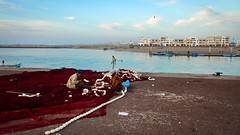Morocco, Rabat - Patiently repairing the fishing nets - December 2015