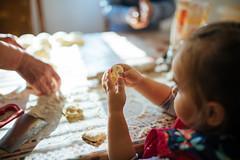 Little girl holding dough closeup.
