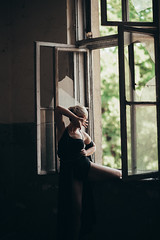 Lonely girl in an abandoned house.
