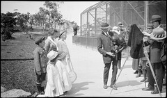 Camera man with orang-outang, Taronga Zoo 1917