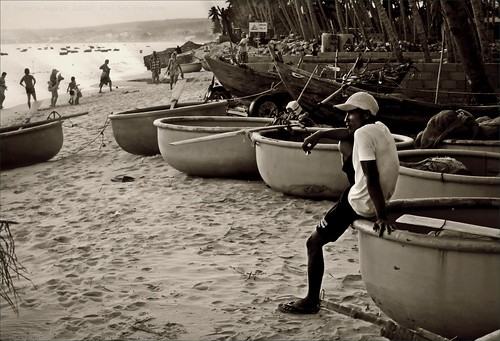 Fisherman in repose. Mui Ne, Vietnam.